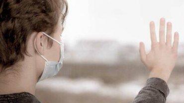 sad-concept-of-coronavirus-quarantine-child-wearing-medical-protective-face-mask-during-flu-virus-lookin