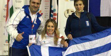 Η Κέλλυ Λουφάκη με τον προπονητή της Δημήτρη Κάζαγλη αριστερά