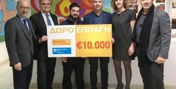 Τα στελέχη της Anytime Κ. Κατσιμπόκης και Μ. Ελευθεριάδης και της INTERAMERICAN Γ. Ρούντος και Χ. Ελευθερίου στη Βάρη, με τον Γ. Πρωτόπαπα, γεν. διευθυντή των Παιδικών Χωριών SOS Ελλάδος και τον Ε. Λοράνδο, διευθυντή του Παιδικού Χωριού Βάρης.