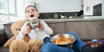 boy-playing-video-games-with-food
